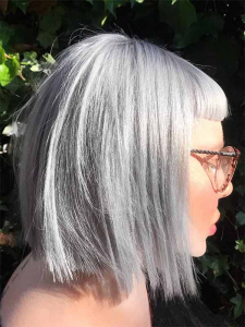 profile face with short fringe and platinum blonde