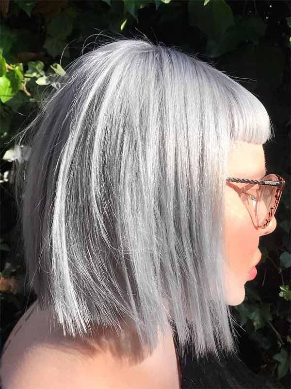 profile face with short fringe and platinum blonde