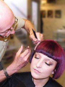 """alt=""""hairdresser cutting fringe"""""""