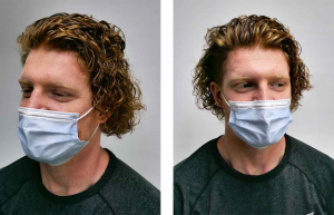 young men this mask on face with new hair perm