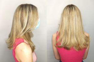 long blonde highlights hair with mask on, side profile